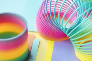 Closeup of rainbow spring toy background