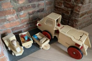 Some versatile toys that can be used over the years with young kids: a handmade train with Tegu blocks and a little truck that he can push, ride, on or put blocks in.