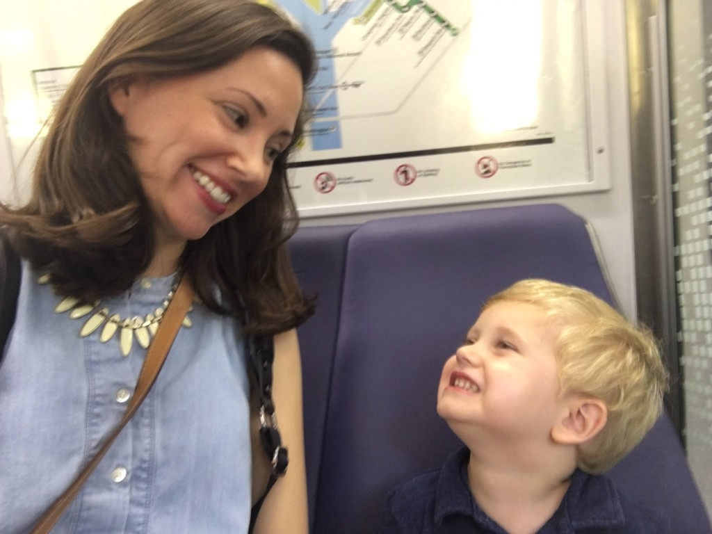 A mother and son are pictured inside a metro car heading into Washington, DC.