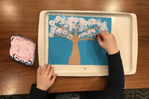 Kids can make a sweet cherry blossom painting with a thumbprint or small sponge stamper.