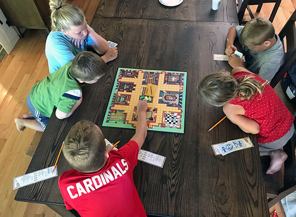 playing board games with our kids