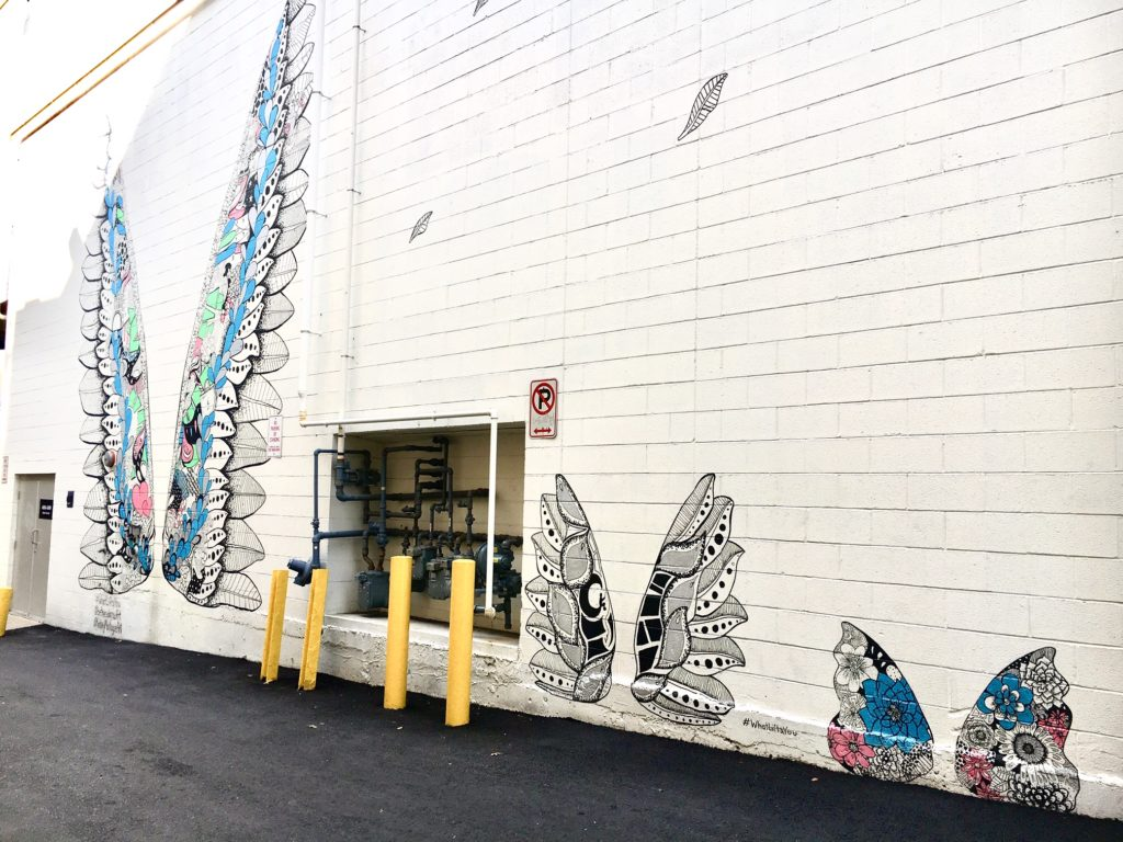 An alleyway in Bethesda Row is the location of three pairs of painted wings, which are part of the What Lifts You series by artist Kelsey Montague.