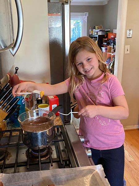 kids making chocolate covered clementines