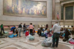 Guests roll out their sleeping bags to spend the night in the rotunda of the National Archives. Photo  by Susana Raab, National Archives and Records Administration.