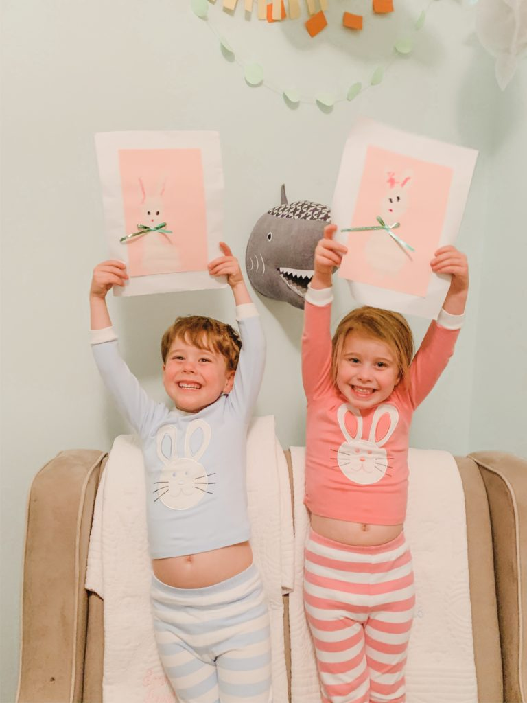 Kids show off Easter bunny craft made with footprint