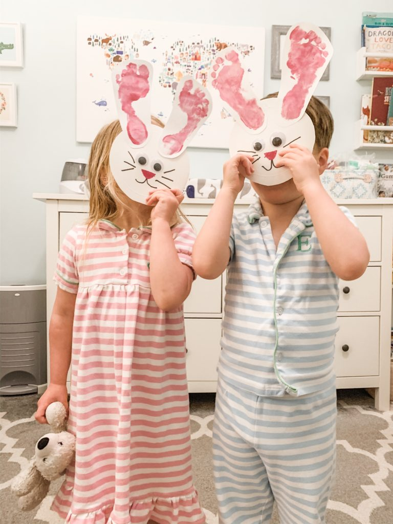 Twins show off footprint Easter bunny craft.