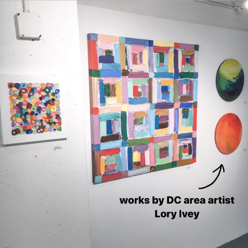 A colorful grouping of contemporary paintings by Lory Ivey Alexander Anne Marie Coolick on display in a gallery.