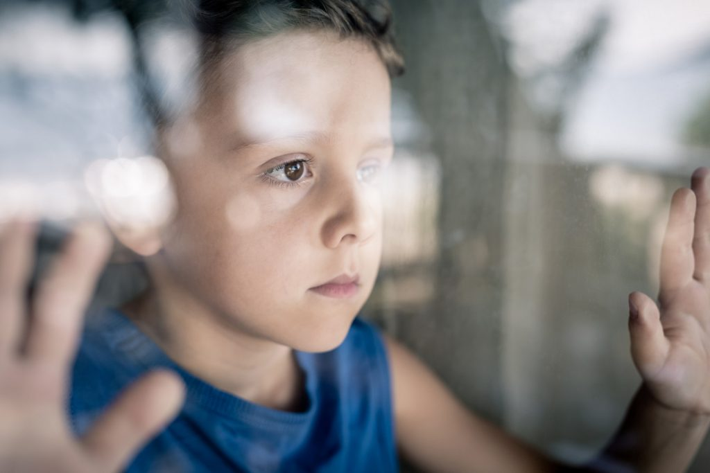 boy looking out the window